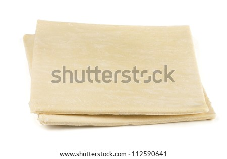Two sheets of frozen puff pastry isolated on white - stock photo