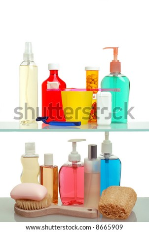Two Shelf Medicine Cabinet with toothbrush and soap, loofah and lotion isolated over white - stock photo