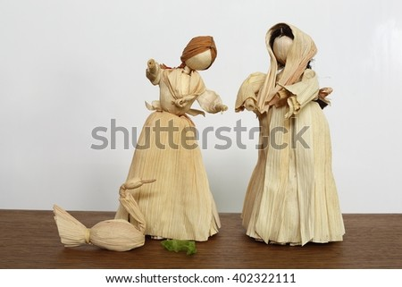 Two shepherdesses and goose (made from corn husks). Easter decoration. - stock photo