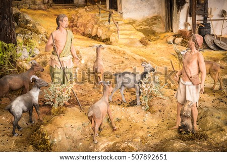 Two shepherds with a herd of sheep