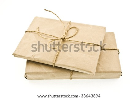 Two shipping package sent through the mail - stock photo