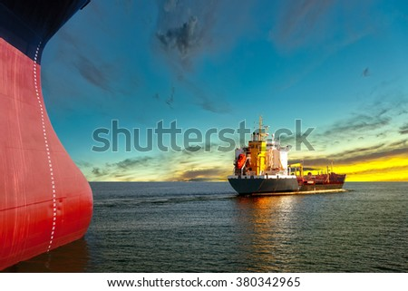 Two ships on the sea at sunset. - stock photo