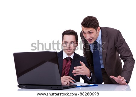 two shocked business men looking at something on their computer - stock photo