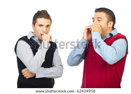 Two shocked men  looking away  and holding hands to mouth isolated on white background