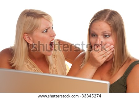 Two Shocked Women Using Laptop Isolated on a White Background. - stock photo