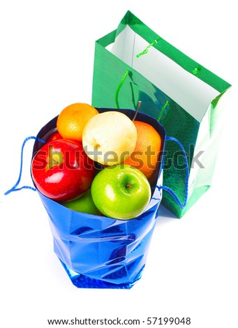 Two shopping bags empty and full with fruits over white - stock photo