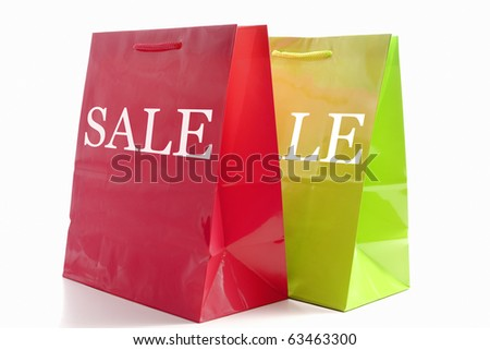 Two shopping bags front angled with a slight drop shadow. - stock photo
