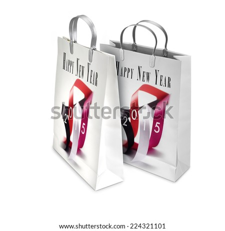 Two Shopping Bags opened and closed with New years greetings isolated on white. There is a different path for each bag - stock photo