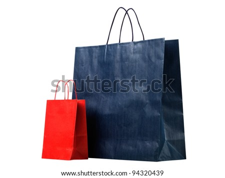 Two shopping bags, red and blue - stock photo