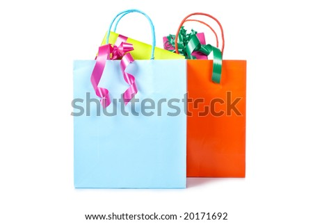 Two shopping bags with gifts inside with soft shadow on white background. Shallow depth of field - stock photo