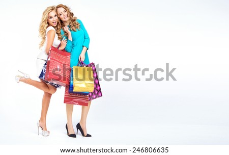 Two shopping girls - stock photo