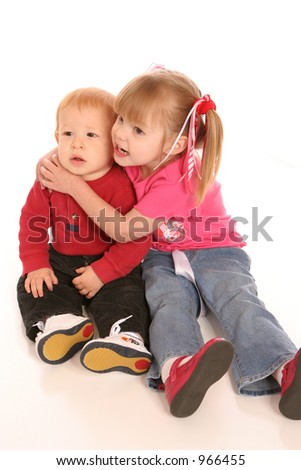 two siblings hugging