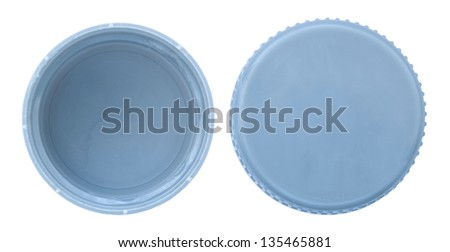 Two sides of a silver plastic bottle cap as seen from directly above. Isolated on white background. - stock photo