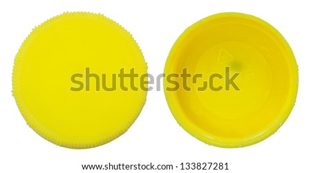 Two sides of a yellow plastic bottle cap as seen from above, one of the top side and two of the bottom side. Isolated on white background. - stock photo