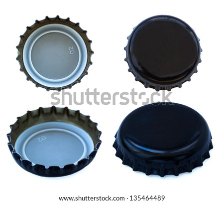 Two sides of black colored metal cap, used for glass soda bottles, seen from high angle as well as frontal views. Isolated on white background. - stock photo