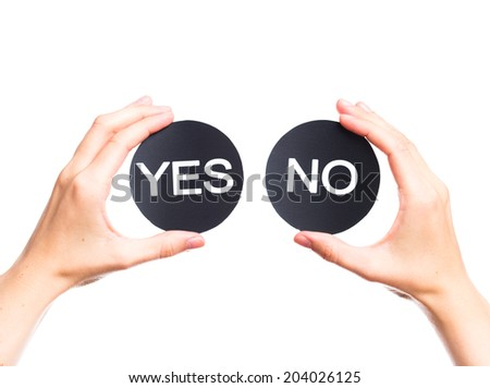 two signs in female fists saying yes and no isolated on a white background.  - stock photo