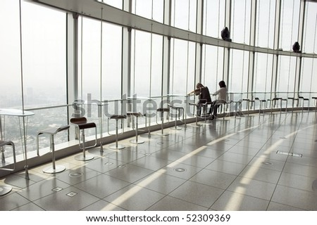 two silhouettes on the big window with panoramic view of Tokyo, Japan - stock photo