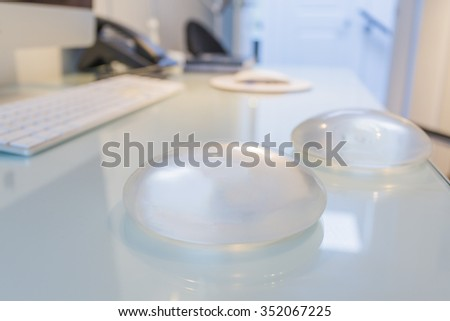 Two silicone breast implant in doctor office - stock photo