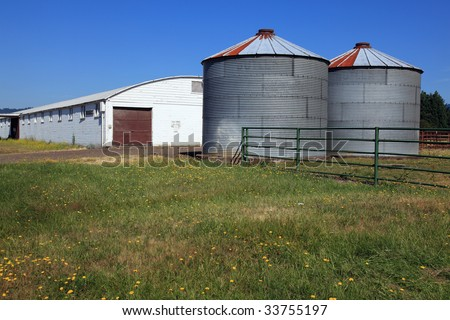 Two silos in front of a warehouse in rural Oregon