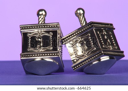 two silver dreidels a traditional Jewish game - stock photo