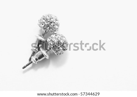 two silver earrings on white - stock photo