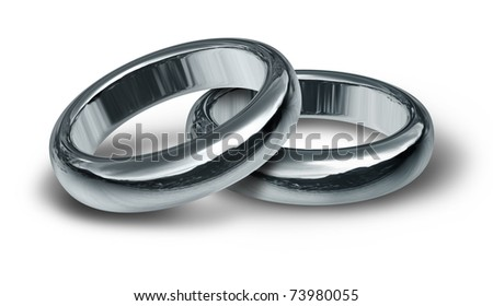 Two silver wedding rings resting on an isolated background representing the start of a new life and relationship.. - stock photo