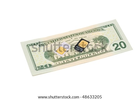 Two SIM cards for cellular phones on dollar bill isolated - stock photo
