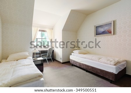 Two single beds in cozy hotel room