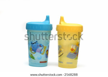 Two sippy cups isolated against a white background - stock photo
