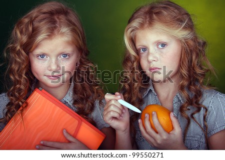two sister posing in studio - stock photo
