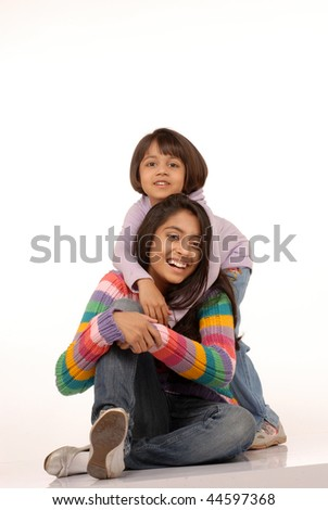 two sisters embracing over white background