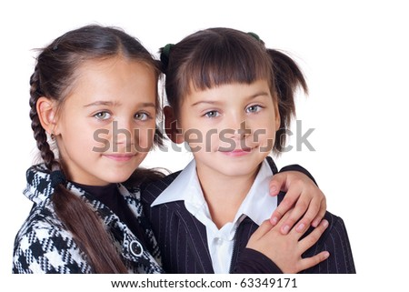 Two sisters have embraced, a white background