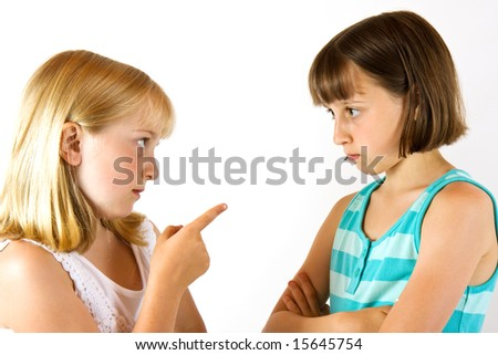 Two sisters having a fight against a white background
