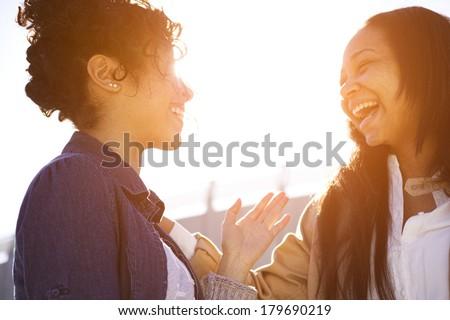 two sisters having fun around town - stock photo