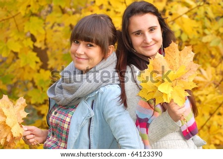 Two sisters in the autumn