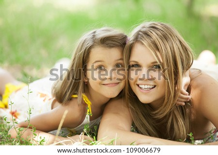 Two sisters in the park. - stock photo