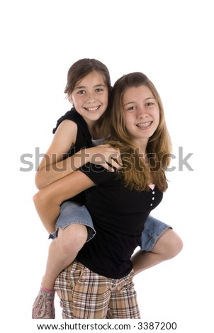 Two sisters joking around. family, friends, growing up - stock photo