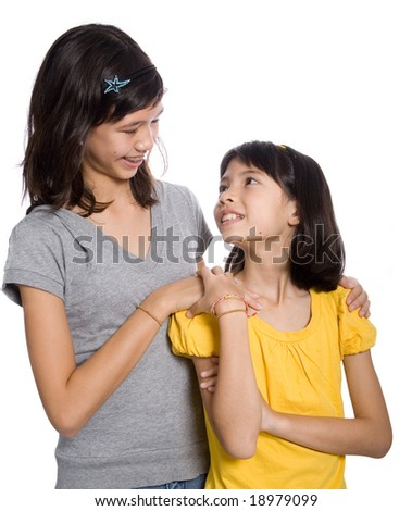 Two sisters looking at each other. Isolated - stock photo