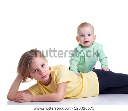 Two sisters lying on a white background