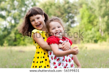 Two sisters on the nature - stock photo