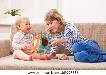 two sisters playing educational games