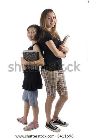 Two sisters stand back to back with school books. Going to school is your future. Education, - stock photo