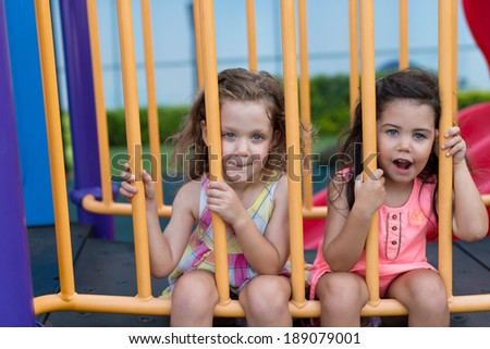 Two sisters tired after playing - stock photo