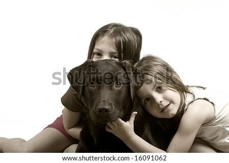 Two Sisters with Chocolate Labrador - stock photo