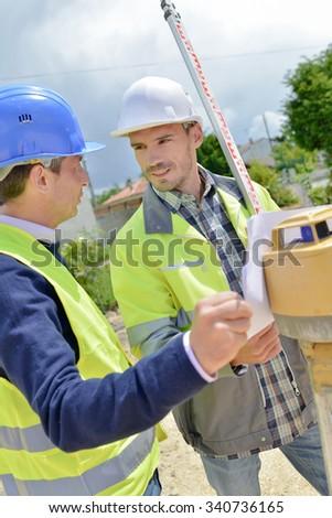 Two site surveyors on a job - stock photo