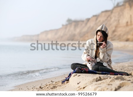 Two sitting by the seashore - stock photo