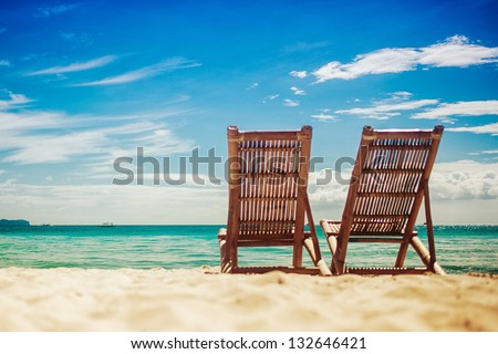 Two sitting place in a tropical beach - stock photo