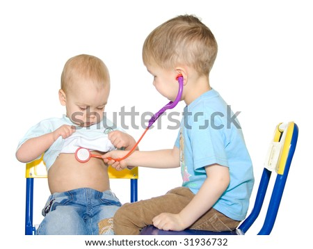 Two sittings kids playing doctor. White background - stock photo