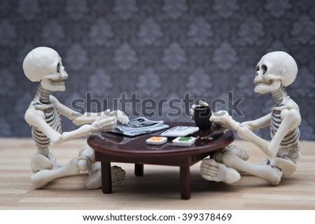 Two skeletons having meal on Japanese style table