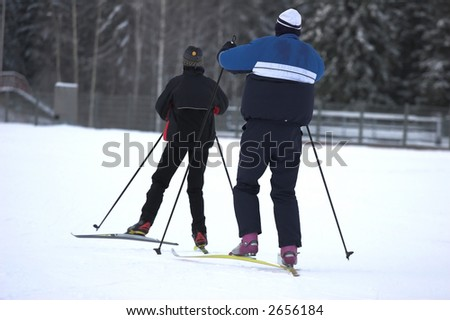 two skiers - stock photo